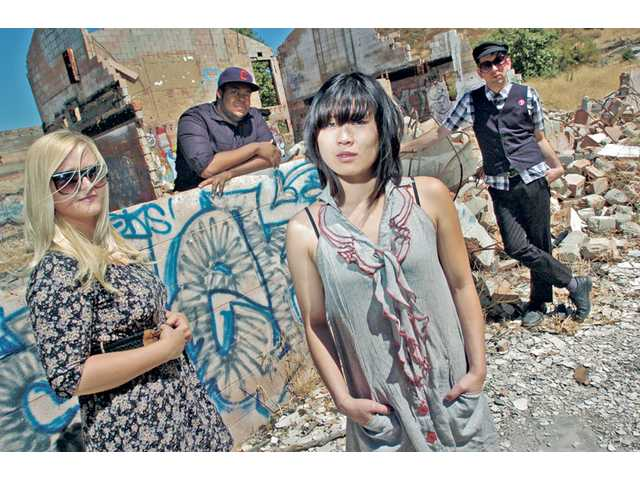 "From left, ""Little Rock"" film producers Sierra Leoni and Frederick Thornton, actress Atsuko Okatsuka and director Michael Ott stand among the ruins of an abandoned building strewn with graffiti resembling the location of their film."