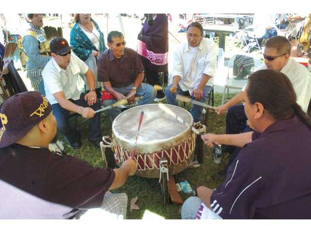 Members of the Hale and Co. Drum Group create the beat for an intertribal dance nearby. Native American groups and park visitors enjoyed cultural arts and crafts despite 100-degree heat.
