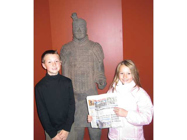 Jon and Laine Matkin, fourth- and second-grade, respectively, in Washington, D.C.  They got lucky enough to get tickets to see the terracotta soldiers in from China, hosted by the National Geographic museum. No photos were allowed in the actual exhibit, but there was a replica of a soldier at the end of the exhibit where we could take pictures.