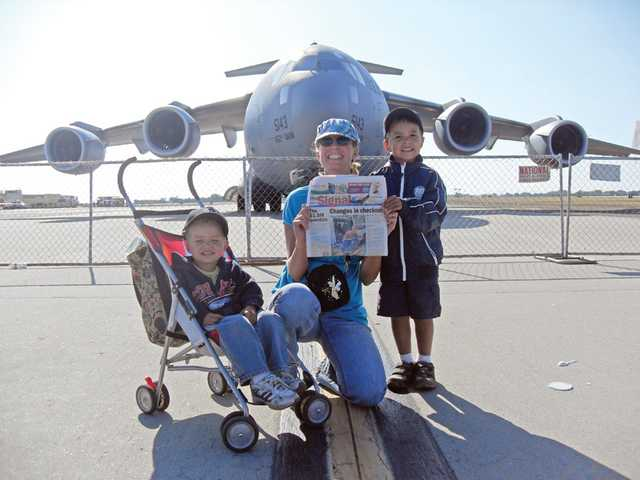 Newhall residents Kim Magana and her sons Fernando Jr., 2, and Gabriel, 4, pose in front of a cargo plane at the Point Mugu Navel Air Station open house. They also had an opportunity to enjoy watching the Air Force Thunderbirds in action.