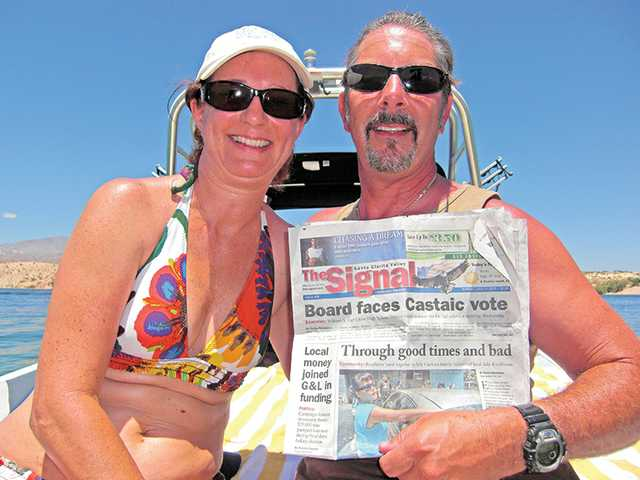 Amy Bibicoff, left, and Bruce Bibicoff, of Castaic, sit on the back of their wakeboard boat at Lake Mojave in July as part of a vacation in Laughlin, Nevada, with Amy Bibicoff's sister and brother-in-law.