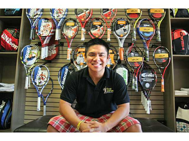 Francis Dimaya, owner of First Serve Tennis Shop, had a grand opening for his store on Sept. 25, when he gave away gifts through a raffle. The store's located in the Plaza del Rancho shopping center on the corner of Newhall Ranch and Dickason Drive.