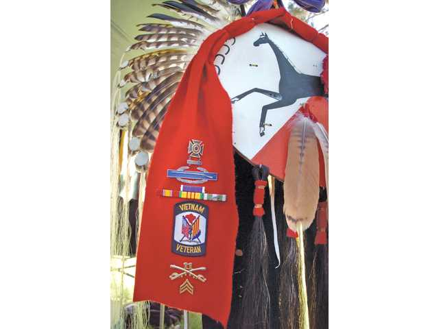 Vietnam War veteran Mike Willis' rawhide war shield decorated with hawk feathers, horse hair and the black horse emblem of the 11th Armored Cavalry Division was on display at the 2010 Pow Wow and Native American Craft Fair held at William S. Hart Park in Newhall on Sept. 25. The two-day event celebrated Native American culture.