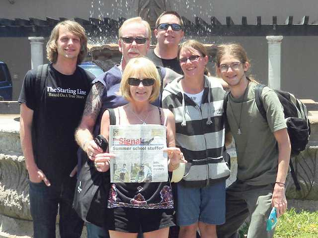 From left, Trent Teebken, Phil Defibaugh, Patty Defibaugh, Nathan Defibaugh, Jamie Defibaugh and Kevin Figatner brought a copy of The Signal with them during a recent trip to the Pueblo Bonito Sunset Beach Resort in Cabo San Lucas, Mexico.