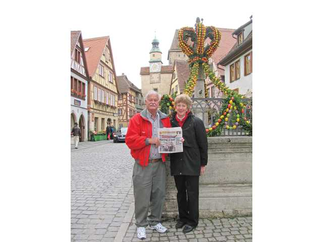 Wayne and Ernestine Peirce took their copy of The Signal to Rothenburg ob der Tauber, Germany during a recent trip. To preserve the town's historical importance during World War II, American military avoided the use of artillery, and Germans ignored Hitler's orders and surrendered the town.