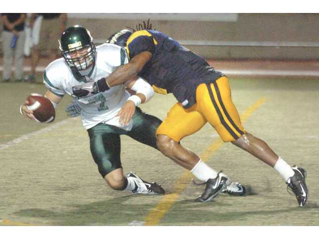 College of the Canyons linebacker Gary Johnson, right, sacks Grossmont quarterback Ryan Woods on Saturday at COC.