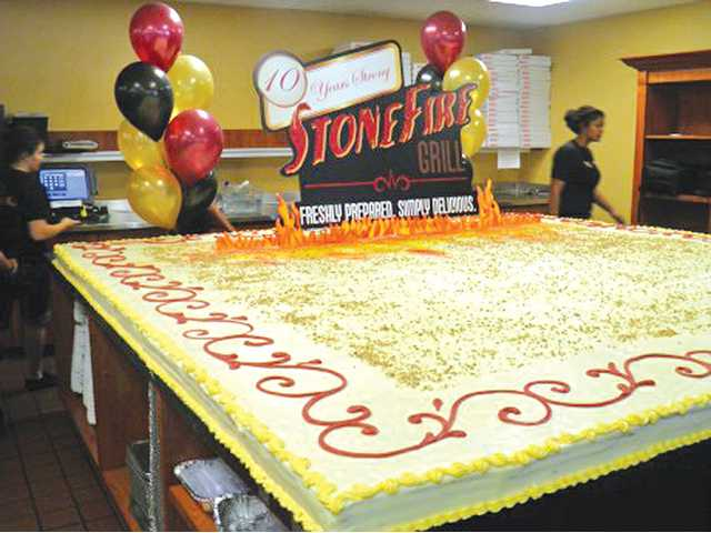 Stonefire Grill celebrated its 10th anniversary recently by baking a 10-foot-by-10-foot carrot cake.