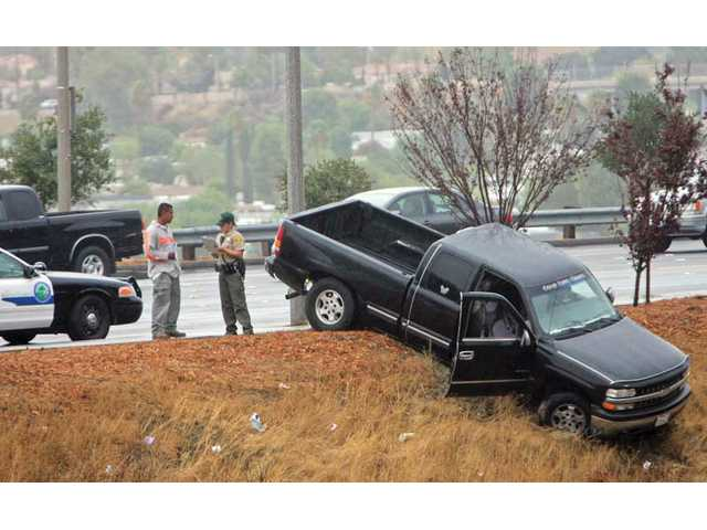 Truck goes over sidewalk in Canyon Country
