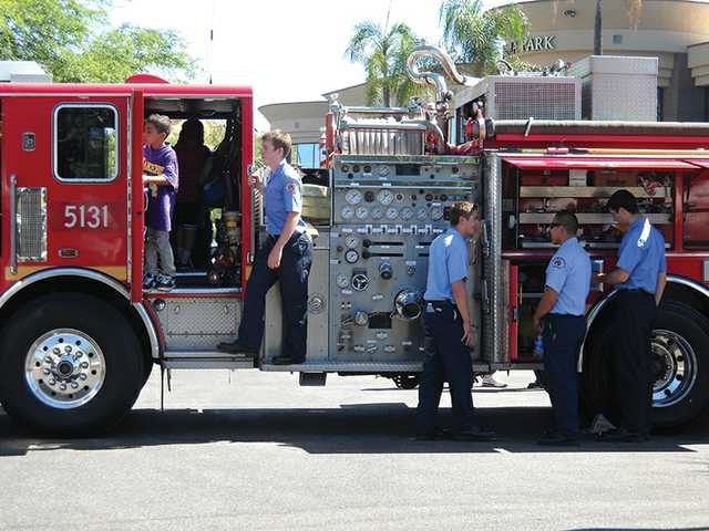 The Los Angeles County Fire Department brought a fire engine for children to tour.