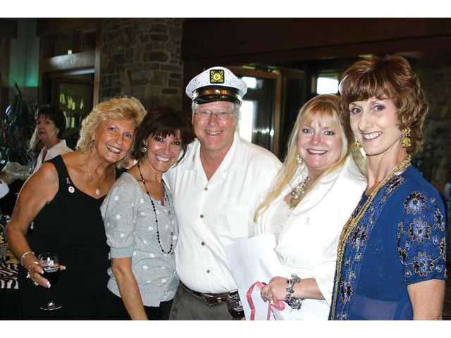 Judy Penman, Sharyn Buncick, Ray J. Tippet, event chair Kathy Rutherford and Colleen Shafer from Circle of Hope celebrate at the event, which raised funds for Circle of Hope and the Sheila R. Veloz Breast Imaging Center.