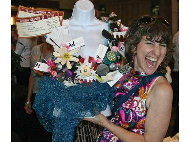 Martha Kelley, of Valencia, was excited over her 'Destination Beauty' bra decorated by Lahoma Cronk, paired with prizes from Tranquility Salon and Spa at the Bras for a Cause benefit held at  the Oaks Grille located inside Tournament Players Club on Sunday.