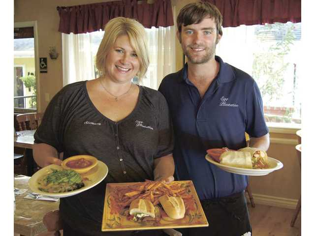 "Egg Plantation co-owner Shannon Mee and server Joel Morey, with several of the vegan and vegetarian dishes offered at the Newhall restaurant, which is open daily from 6 a.m. to 2 p.m. Since January, 2010, Egg Plantation has been a certified ""green"" restaurant."