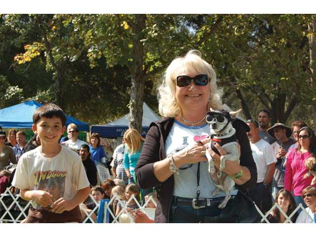 contestant and her Chihuahua take part in the Fun Dog Show, under the category of pet-owner look-alike.
