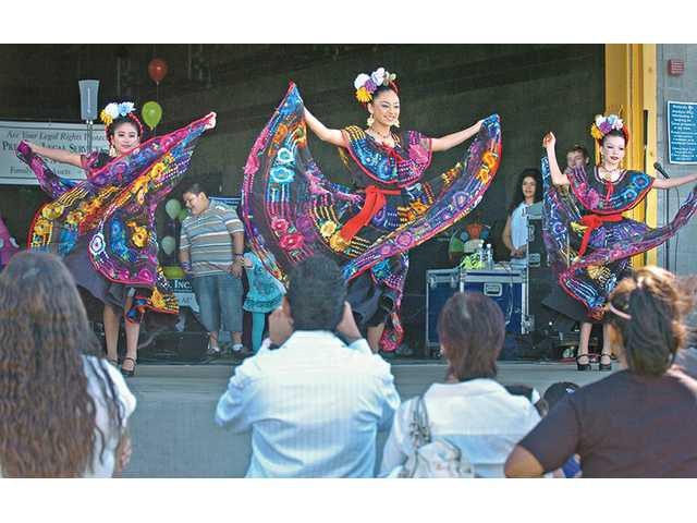 Dancers of the Santa Clarita Valley Ballet Folklorico entertain at the 5th annual Children's Safety Fair held at the Newhall Community Center in Newhall on Saturday.