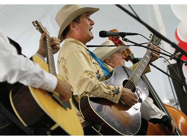 Members of Crosstown Cowboys play country music during the LARC Ranch Western Round Up even held Sunday in Saugus.