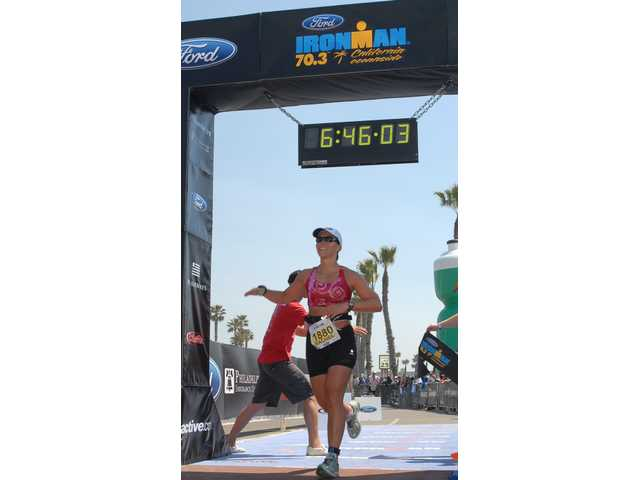 Rachel Cosgrove crosses the finish line in the 2008 Ironman California Half Ironman in Oceanside. The Santa Clarita Marathon will be held Nov. 7 on the streets of the SCV.