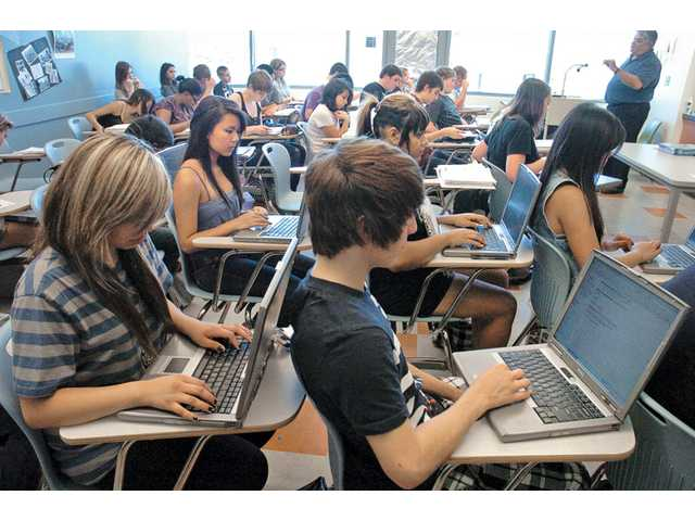 Eleventh-graders in Greg Herrick's history class use laptop computers to research World War I at Academy of the Canyons in Valencia on Sept. 30. The school, which has approximately 400 students, is in its second year of offering grades nine through 12.