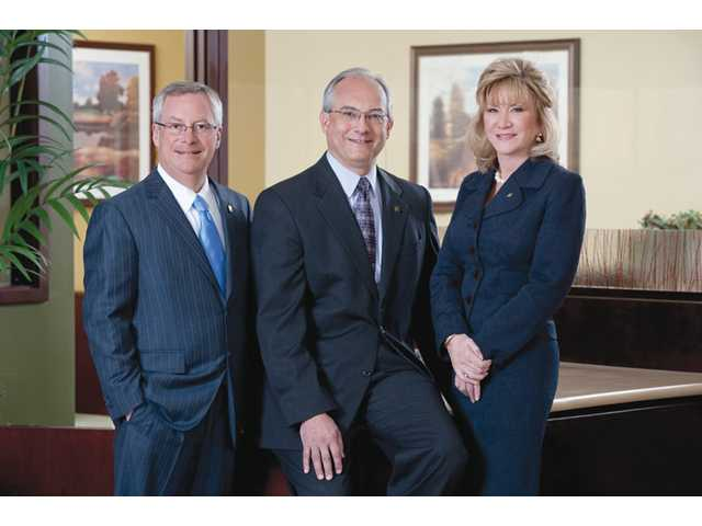 Bank of Santa Clarita founding members and executive team, from left, James Hicken, Frank Di Tomaso and Kimberly Altobello worked in an office without air conditioning, while they labored through the painstaking process of becoming a bank.