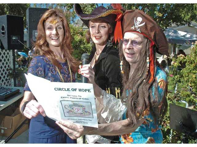 From left, Colleen Shaffer, Jordana Capra and Laird Stuart are dressed for the event. The event theme was Set Sail to Exotic Ports of Call. The fundraiser for the breast cancer support group was held at the home of Colleen  and Clyde Shaffer in Newhall. Colleen Shaffer is the founder of the nonprofit.