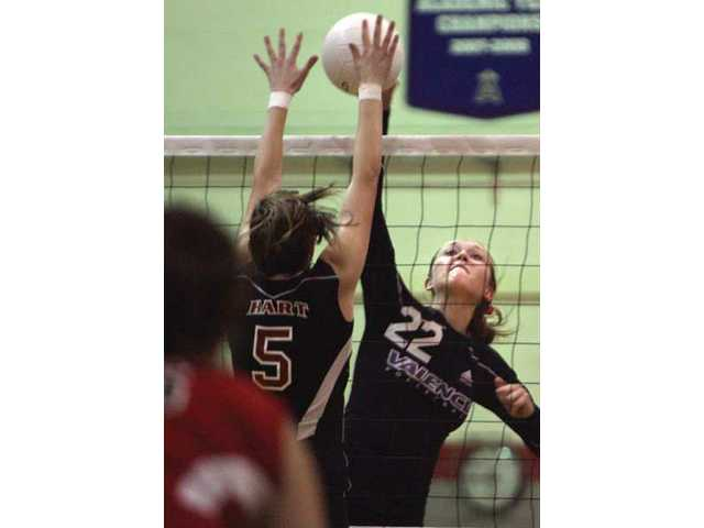 Valencia's Emily Ellias hits the ball as Hart's Brittani Elser challenges her at the net on Wednesday at Hart High.