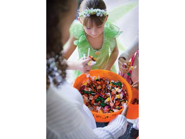 Trick-or-treating is an American Halloween tradition each year. To ensure children's safety during the festivities, there are tips to follow, including supervision by an adult or teen guardian while going from door-to-door, wearing reflective strips or glow sticks on or around costumes, and staying on well-lit streets in familiar neighborhoods.