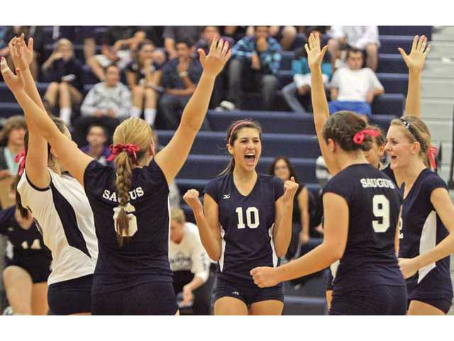 The Saugus girls volleyball team celebrates after beating West Ranch in three games at West Ranch High on Thursday.