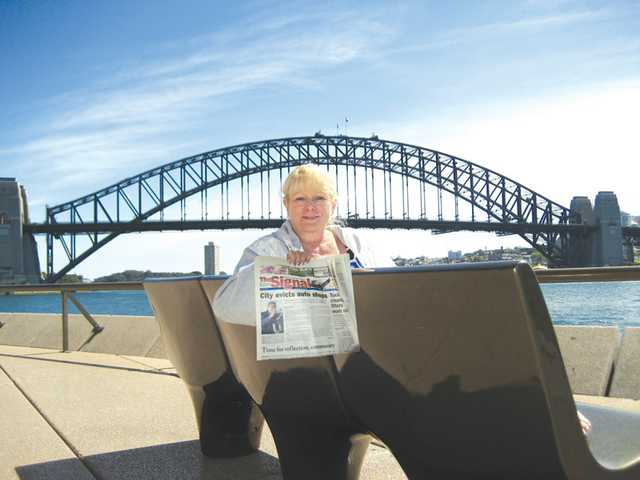 Sally Bond-Wolf poses in front of the Sydney Harbour Bridge while on vacation with her husband, Bill Wolf, in Sydney, Australia in September. Their trip also included a visit to Sir Richard Branson's private Makepeace Island off the coast of Queensland.