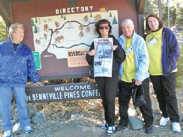 From left to right, Lois Linnert, Kirby Peterson, Dottie Healy and Deana Perozzi stand in front of the directory for the Unitarian-Universalist Association retreat at Camp de Benneville Pines in Angelus Oaks.