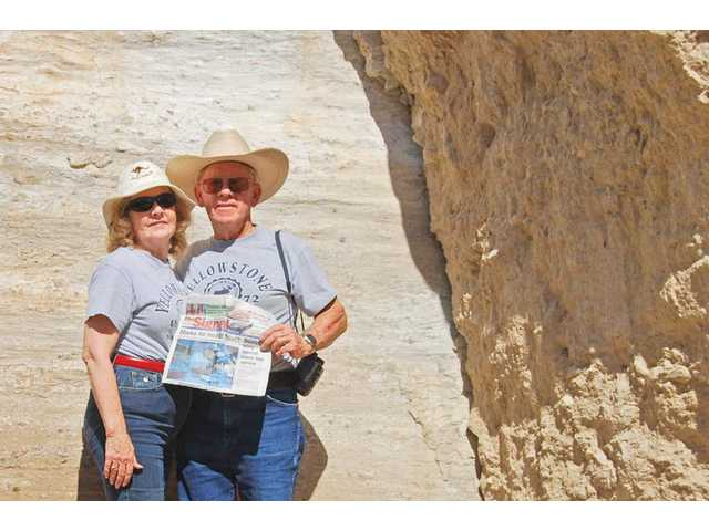 Rod and Nancy Swank, of Castaic, stand in front of the San Andreas Fault near Palm Springs. This section of rock was sheared by the movement of a magnitude 8.0 earthquake that occurred almost 1,000 years ago.