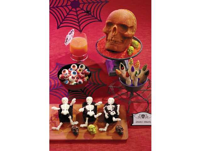 Hard to believe these ghoulish treats are not only edible, but tasty: eyeball candies, skull pound cake, witches' fingers cookies, graveyard mini cakes with skeleton candies and skull candies.