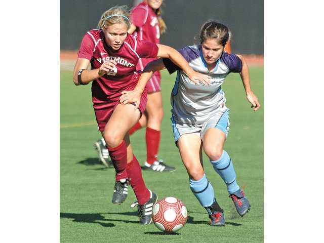 Westmont's Alison Hensley (2) battles for possession with The Master's College's Alissa Adkins on Tuesday at Reese Field.