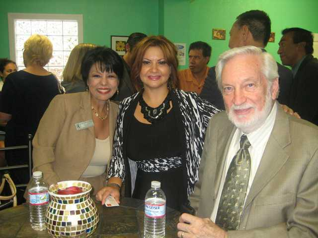 Patricia Gracia, center, Gloria Mercado-Fortine and Bruce Fortine enjoy a business mixer hosted by the Power Women Business Center in September.
