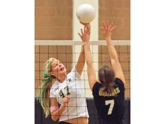 West Ranch's Angel Rutledge (47) tips the ball over the net as Golden Valley's Megan Badovinac defends on Thursday.
