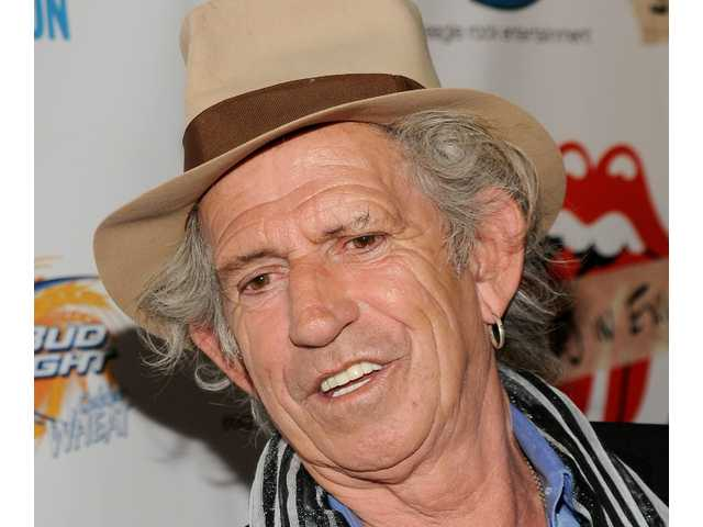 "In this May 11, 2010 file photo, Keith Richards of The Rolling Stones attends a screening of the documentary ""Stones In Exile"" at The Museum of Modern Art in New York. He was guest of honor at the New York Public Library Oct. 29, 2010, as music journalist Anthony DeCurtis interviewed Richards about his autobiography, ""Life."""
