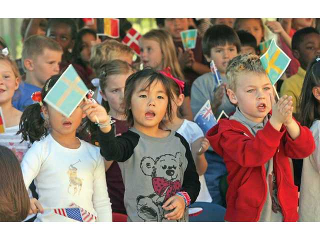 West Creek Academy kindergarten students sing the school's song during a dedication ceremony Tuesday in Santa Clarita.