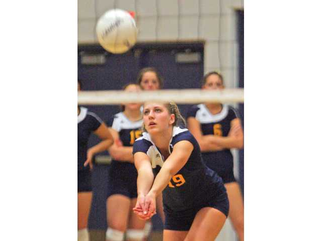 College of the Canyons' Jennie Long returns a serve against Bakersfield on Tuesday night at COC. The Cougars won 3-1.