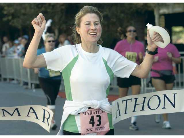 Jennifer Christian-Herman was the first woman to break the tape in the Santa Clarita Marathon in 2009.