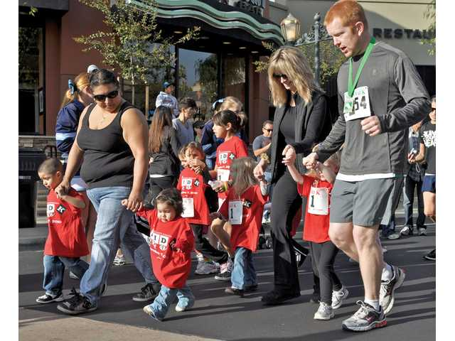 Participants run and walk along Town Center Drive on the Kid K course as part of the Santa Clarita Marathon.