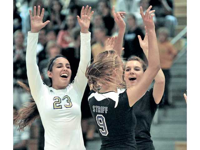 Valencia players Brooke Dawson (23), Sydney Striff (9) and Serena LeDuff celebrate the Vikings' victory over Estancia in the first round of the CIF-Southern Section Division IA playoffs on Tuesday at Valencia High.