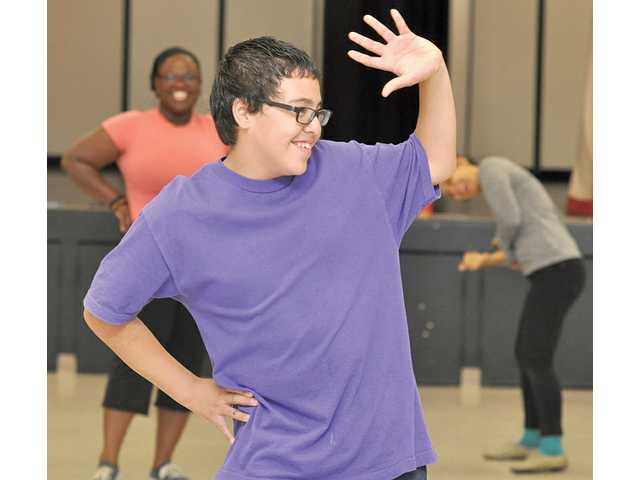 "Efrain Gonzalez, 12, strikes a pose as a runway model in a game of ""What are you doing?"" during a class at Arroyo Seco Junior High School on Nov. 3. The class was facilitated by graduate students of the School of Theater at California Institute of the Arts."