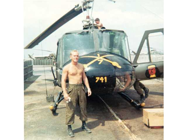 A photo taken in 1969 shows Jones in front of his Huey.