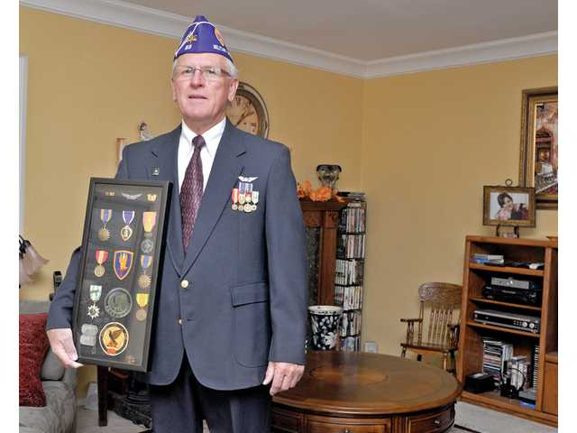 Highly decorated Chief Warrant Officer Thomas Whitlock Jones, of Canyon Country, recently found the helicopter he flew in Vietnam 40 years ago, holds the medals he earned for flying rescue missions in a UH-1Y helicopter during the Vietnam War.