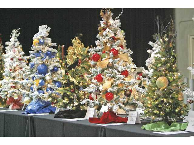 Forty to 45 table top trees will be sold by silent auction at the Festival of Trees.