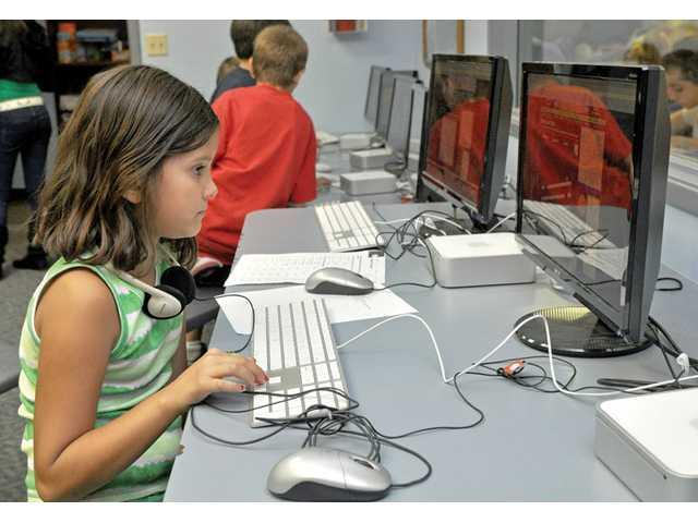 Ariana Barragan, 8, plays a computer game.