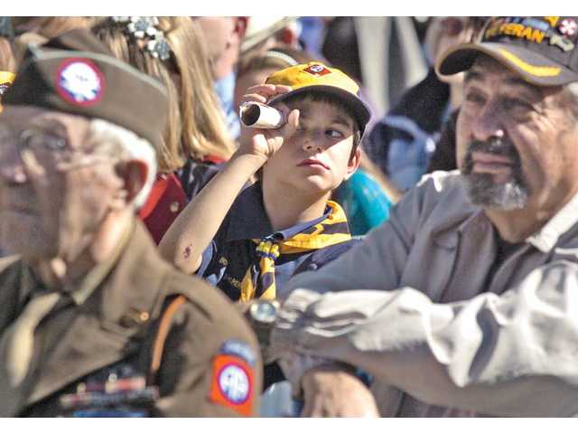 Cub Scout Jeremy Boot, 7, of Pack 58 watched the events on stage through a rolled up event program.