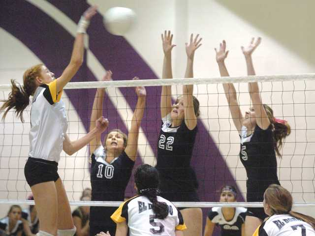 Valencia teammates Carly Carapella (10), Emily Ellias (22) and Ashtyn LaVoise (5) try to block a shot by El Dorado's Kelly Claes on Thursday at Valencia High School. The Vikings advanced to the third round of the CIF-Southern Section Division IA playoffs with a 3-1 win.