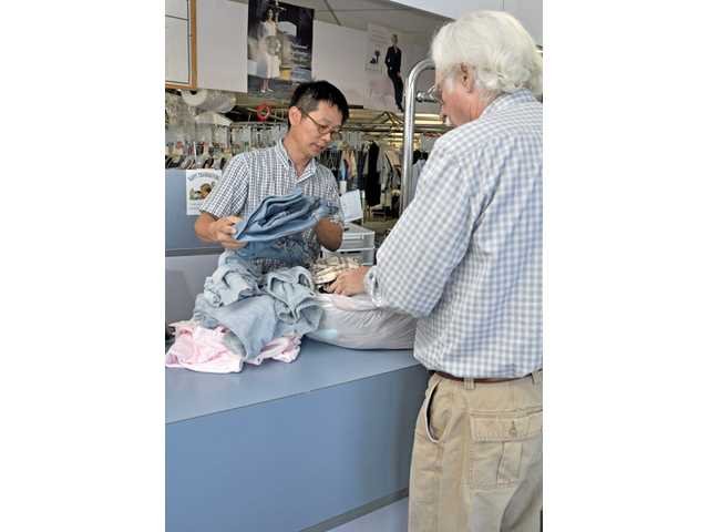 Charity: Mike Chang of  Newhall's Wayman Cleaners makes a difference
