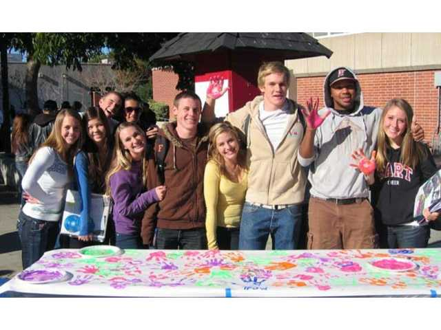 "Students at Hart High School ""mixed it up"" with paint and hand prints on Mix It Up Day on Nov. 9."