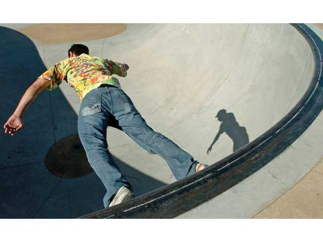 Nouri Ayoub, 20, skates around a bowl on his skateboard at Santa Clarita Skatepark in Santa Clarita on Monday. Sunny weather will continue today with a high of 73 degrees and a low of 48 degrees, according to the National Weather Service.