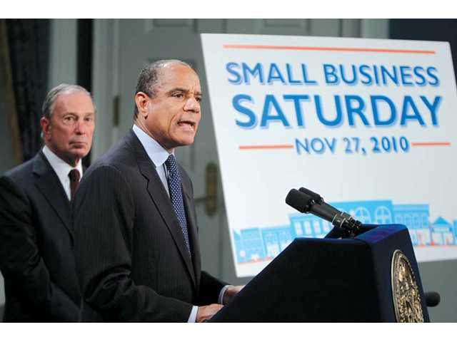 "Kenneth Chenault, CEO of American Express, right, speaks while New York City Mayor Michael Bloomberg listens during a news conference in New York on Nov. 8. American Express and Bloomberg are trying to spur growth for small businesses by launching a program called ""Small Business Saturday"" to fall in between the better known shopping days of ""Black Friday"" and ""Cyber Monday."""